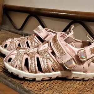 enclosed Pink slip on sandals with scrap on back